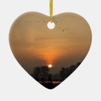 Sunrise at a lake with flying birds. ceramic ornament
