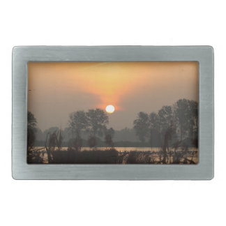 Sunrise at a lake with flying birds. rectangular belt buckles