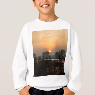 Sunrise at a lake with flying birds. sweatshirt