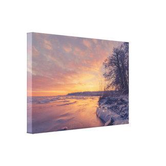 Sunrise by a frozen sea shore canvas print