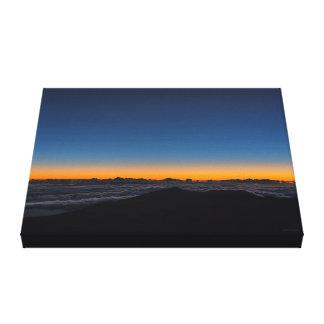 Sunrise on the horizon at Mt. Haleakala Canvas Print
