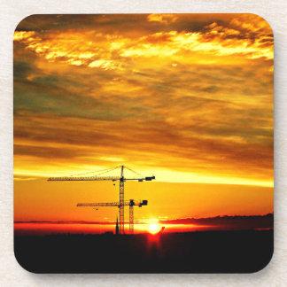 Sunrise silhouetting Cranes Beverage Coaster