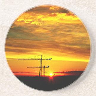 Sunrise silhouetting Cranes Coasters