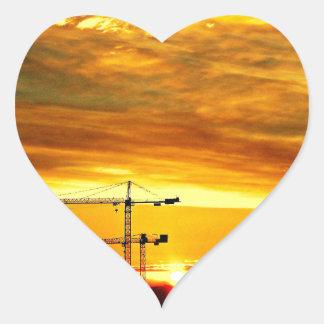Sunrise silhouetting Cranes Heart Sticker