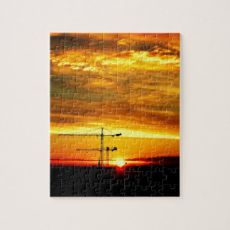 Sunrise silhouetting Cranes Jigsaw Puzzle