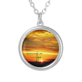 Sunrise silhouetting Cranes Silver Plated Necklace