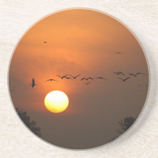 Sunrise with flocks of flying cranes drink coasters
