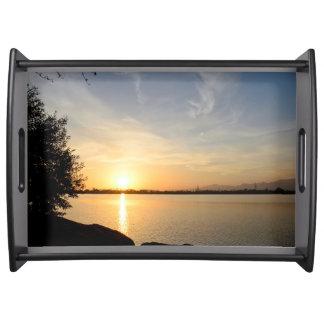 Sunset at lake serving platters
