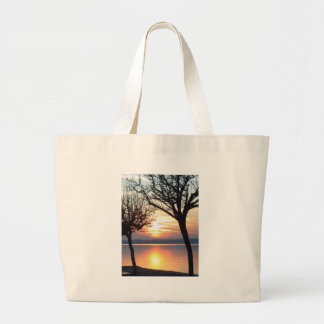 Sunset at the lake canvas bags