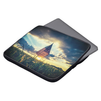 Sunset behind the flag laptop computer sleeves
