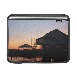 sunset by the lake waterfront with deck buildings MacBook sleeve