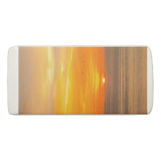 Sunset Coast with Orange Sun and Birds Eraser