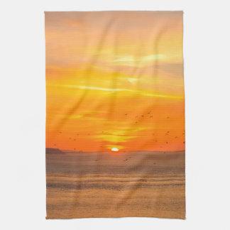 Sunset Coast with Orange Sun and Birds Tea Towel