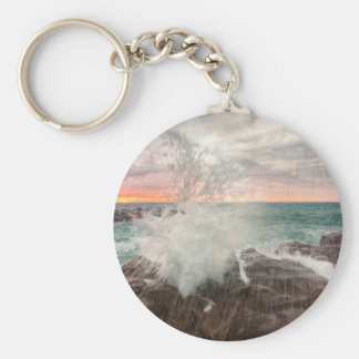 Sunset from a rocky beach key ring