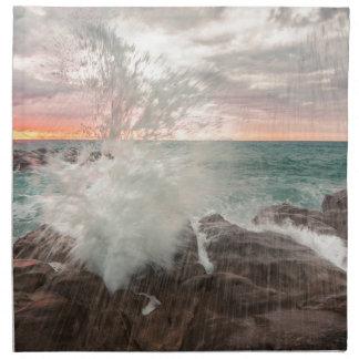 Sunset from a rocky beach napkin