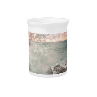 Sunset from a rocky beach pitcher