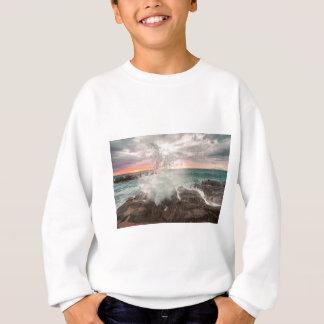 Sunset from a rocky beach sweatshirt