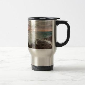 Sunset from a rocky beach travel mug