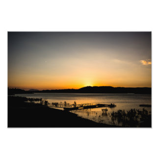 Sunset on a lake with a jetty in the foreground photo print