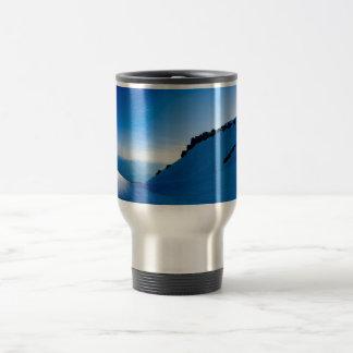 Sunset on a snowy mountain travel mug