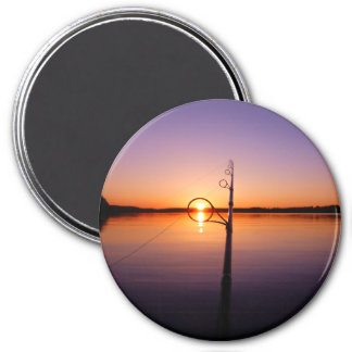Sunset on a summer lake seen through a fishing rod 7.5 cm round magnet