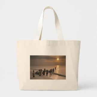 Sunset on shore of the Baltic Sea Tote Bags