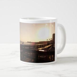 Sunset on the pier giant coffee mug