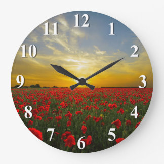 Sunset Over A Red Poppy Field Large Clock