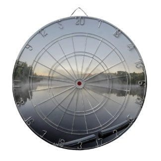 Sunset over lake dartboard with darts