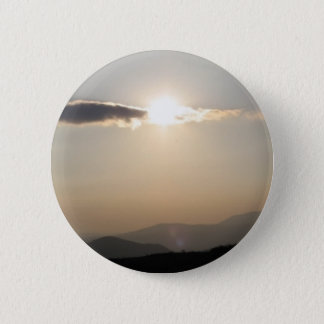 Sunset over mountains 6 cm round badge