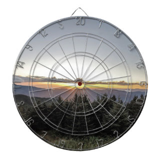 sunset over mountains dartboard with darts
