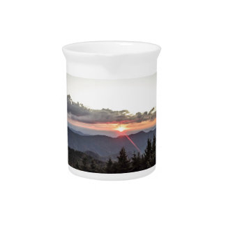 sunset over mountains pitcher