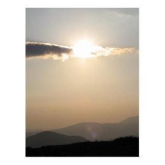 Sunset over mountains postcard