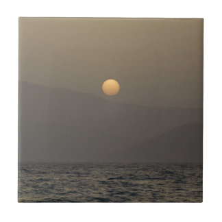 Sunset over Paros island mountains Ceramic Tile