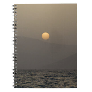 Sunset over Paros island mountains Notebook