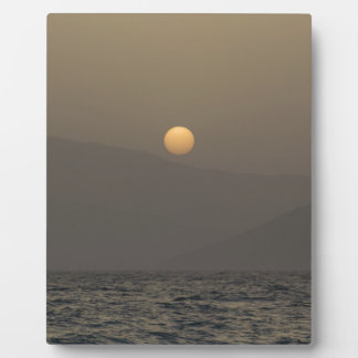 Sunset over Paros island mountains Plaque
