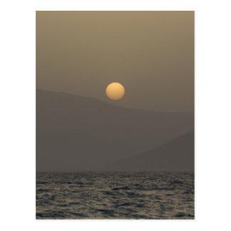 Sunset over Paros island mountains Postcard