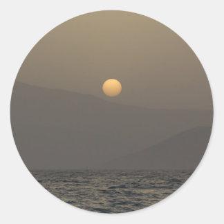 Sunset over Paros island mountains Round Sticker