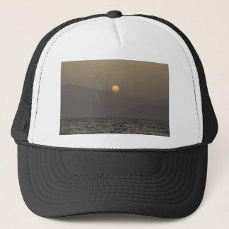 Sunset over Paros island mountains Trucker Hat