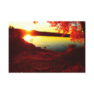 sunset over the River during fall Canvas Print