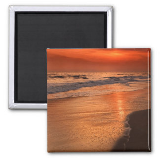 Sunset reflections off clouds and ocean shore square magnet