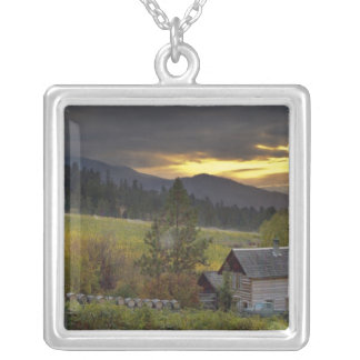 Sunset sky over vineyards and historic log cabin square pendant necklace