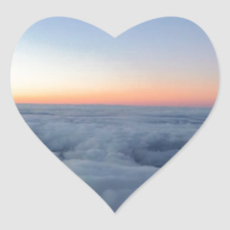 Sunset sky view flying above the clouds heart sticker