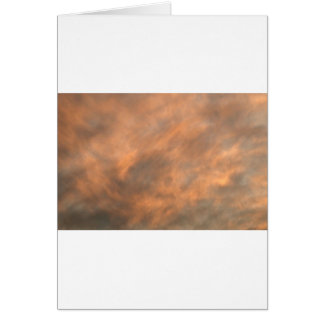 Sunset through clouds. card
