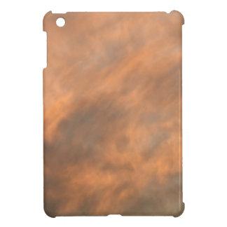 Sunset through clouds. iPad mini cases