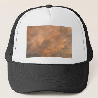 Sunset through clouds. trucker hat