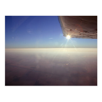 Sunset under wing postcard