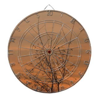 Sunset whit tree branches, colorful sky dartboard