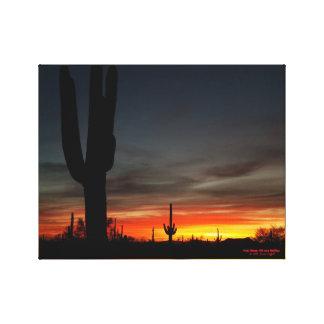 Sunset with giant saguaro cactus in Arizona desert Canvas Print
