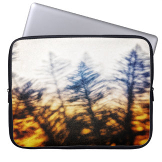Sunset with pine tree silhouette laptop sleeve